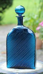 Cobalt blue Flindari decanter with a circular stopper and an exterior relief decoration designed by Nanny Still (born 1926) for Riihimaki Glass Works, Finland
