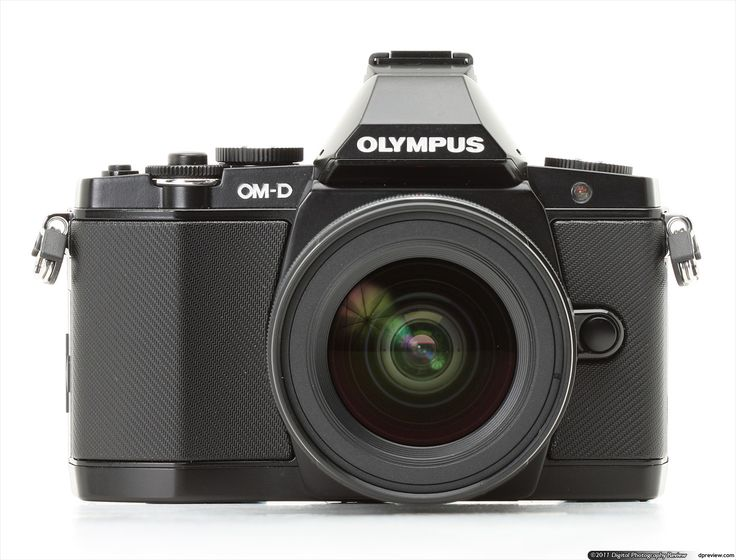 Olympus OM-D E-M5 Review: Digital Photography Review - this may be the one! Relatively small and very capable.