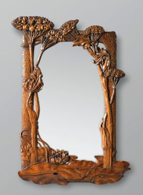 A CARVED WALNUT MIRROR BY JACQUES GRUBER, CIRCA 1900-1905. SIGNED