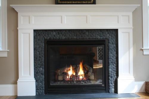 Charcoal black River rock fireplace