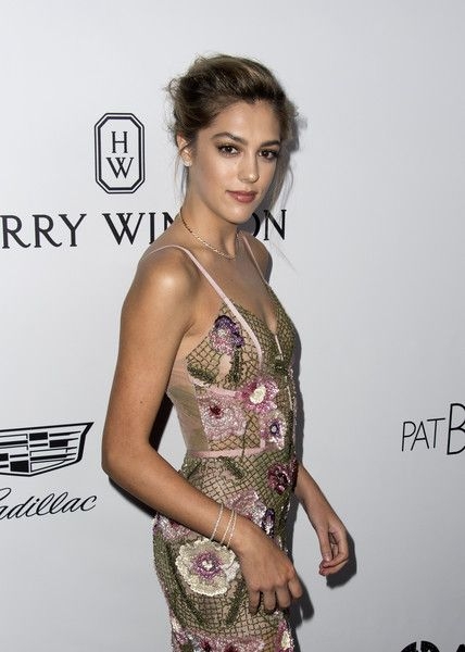 Sistine Stallone Photos - Model Sistine Stallone attends the amfAR Gala Los Angeles honoring actress Julia Roberts on October 13, 2017 in Beverly Hills, California. / AFP PHOTO / VALERIE MACON - amfAR Los Angeles 2017 - Red Carpet