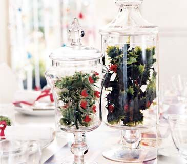 Faux Fabulous~ Plastic greenery tends to look, well, plastic. But place boughs of holly, evergreens, or mistletoe in clear glass jars or vases and they make for a glossy yet understated table decoration. In groups of 3 for a Bigger statement.