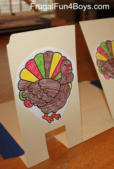 Use file folders to make turkey targets that pop back up after you shoot them with Nerf guns.  Great fun for turkey day!!