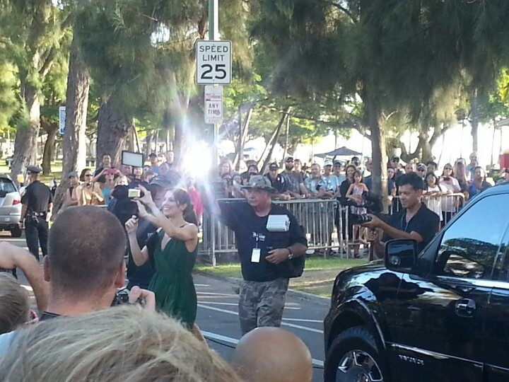 MICHELLE BORTH from Hawaii Five o h50 taking pics of her fans at the premiere in Waikiki. 9-23-12