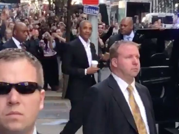 Former President Barack Obama caused quite a commotion Friday when he stopped inside a New York City office building.    A large crowd gathered outside, trying to catch a view of Obama as he left 160 Fifth Avenue in Manhattan.    In the liberal enclave of Manhattan, Obama was met with loud cheers as he walked to his motorcade.    (Barack Obama.Allan Smith/Business Insider)