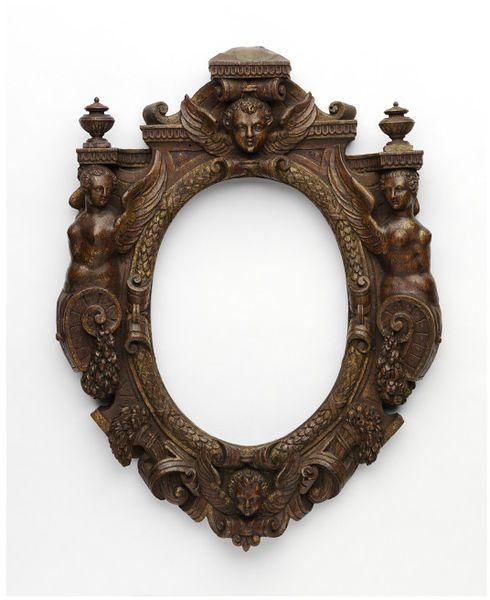 Carved walnut oval sansovino style frame, partially mordant gilded oval frame
