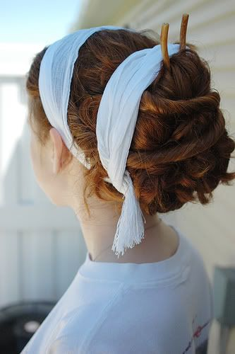 This is a good example of the hair wraps adorning many Roman hair styles. Though the original ones are more likely to be made of finer fabrics and ribbons.