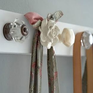 Take a board, sand and paint it. Add your favorite cabinet pulls to make a one of a kind purse or coat rack. Charming!