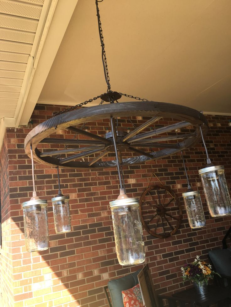 25+ best Wagon wheel chandelier ideas on Pinterest   Wagon ...