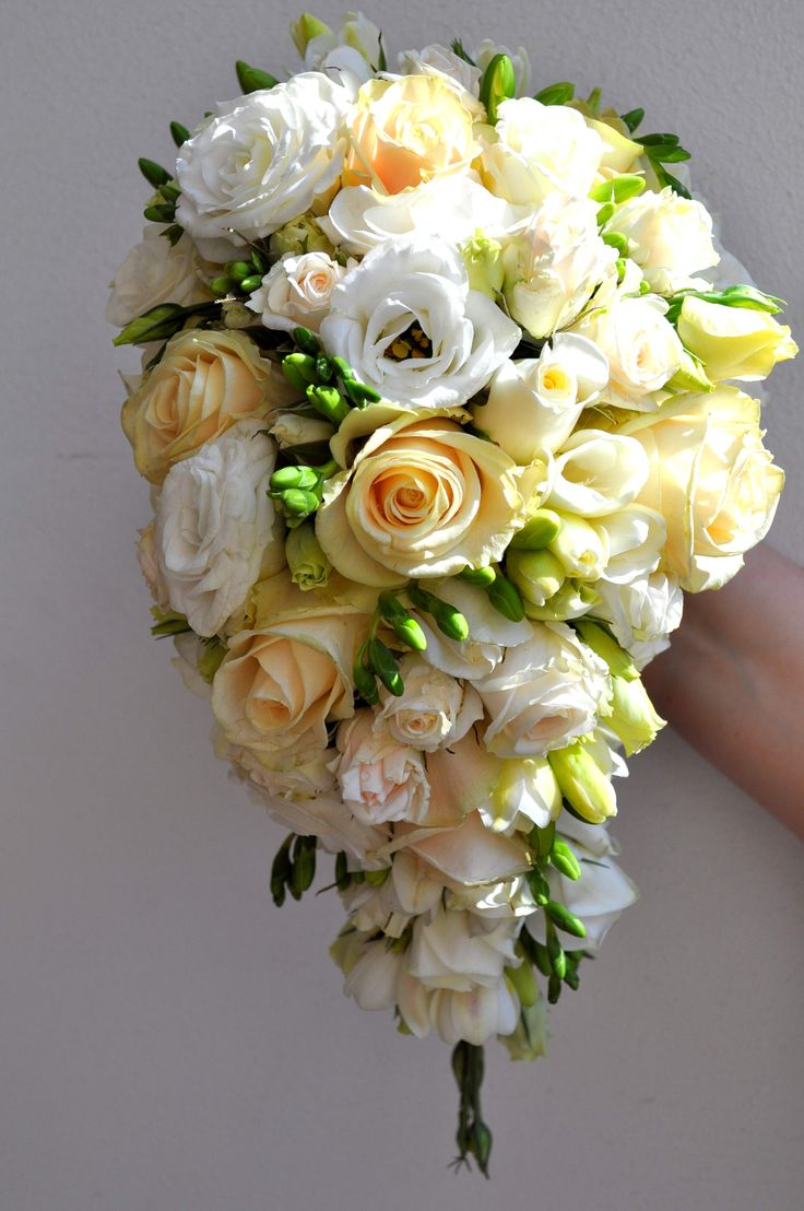 Drop shape bouquet in cream and white tones - designed by Arioso.