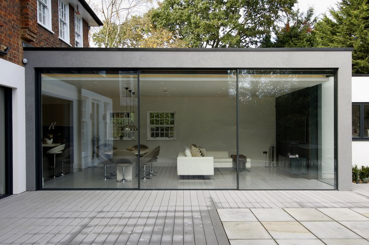 exterior view of minimal windows to rear extension in London showcasing their minimal framing www.iqglassuk.com
