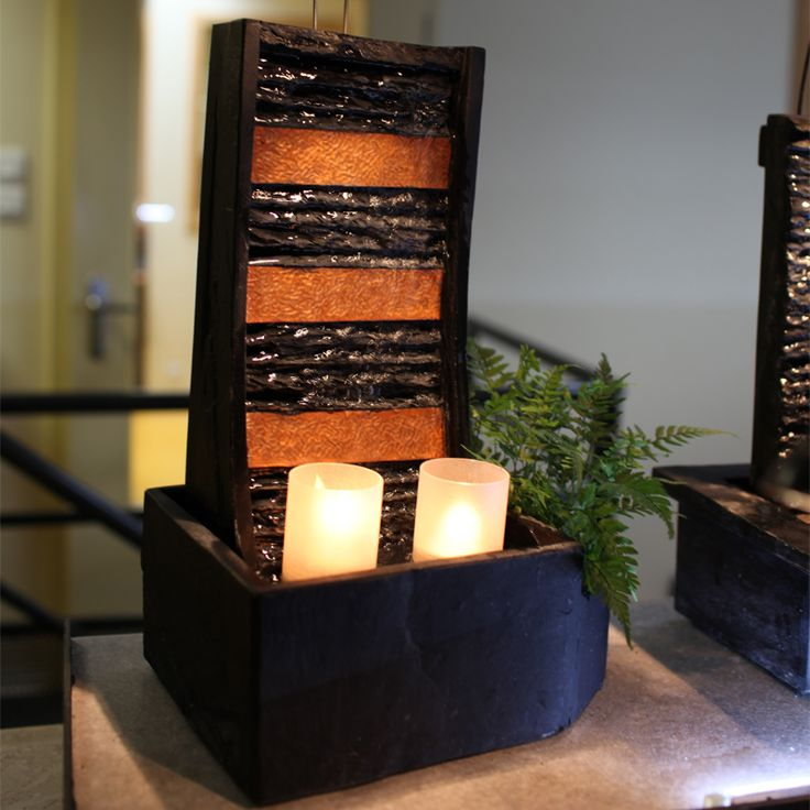 Small fountain by Cactose, made of hammered copper and slate, with candles and plants.  www.cactose.fr