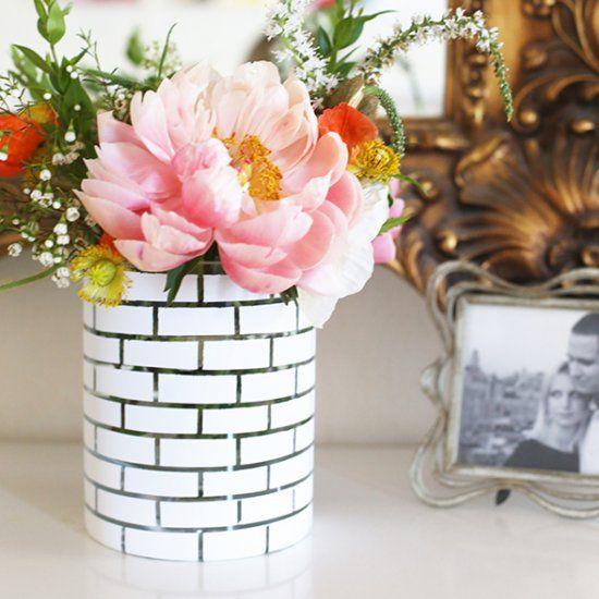 Make this simple + gorgeous white brick vase using thin tape and white spray paint