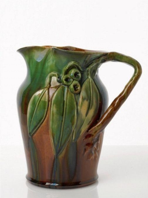 Remued, earthenware jug of squat shape with brown underglaze… - Remued - Ceramics - Carters Price Guides to Antiques and Collectables