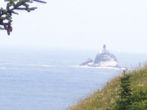 Tillamook Rock Lighthouse near Cannon Beach, Oregon.  A Travel Guide to Murder
