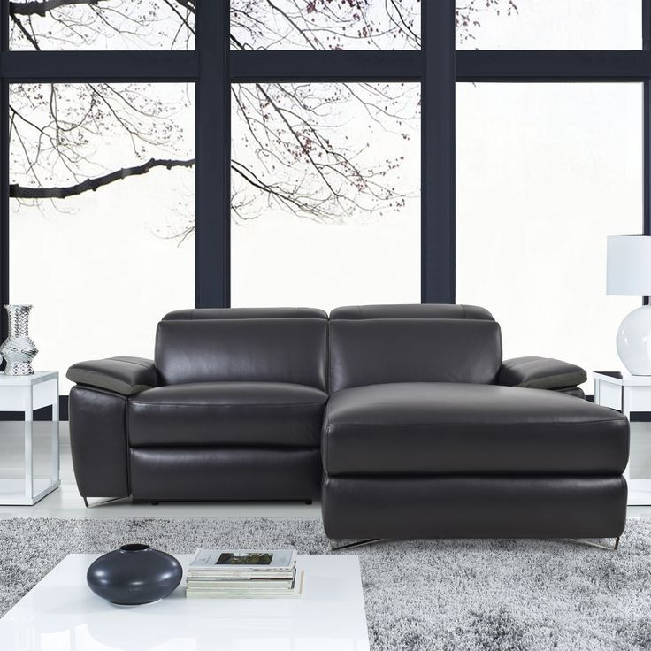 Enjoy sophisticated comfort and style with the Aura Black Top Grain Leather Power Reclining Small Sectional Sofa with Right Facing Chaise by Levoluxe. This compact designer sectional includes a power reclining seat and a right-facing grand chaise, and offers a modular design for custom configuration. Featuring  an adjustable headrest and footrest support. Recline with the touch of a finger and relax in an ambiance of refined modern elegance.