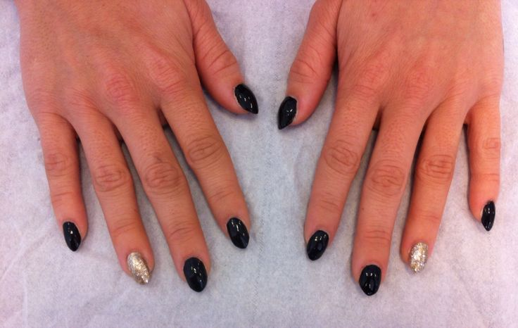 A set of acrylics with black and gold glitter polish