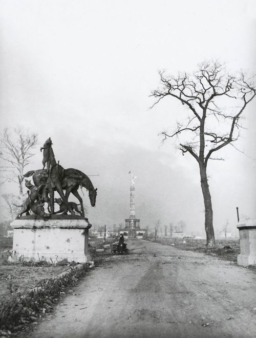 "Großer Tiergarten, Berlin, Germany, circa 1946-1949    ""Noch heute kann man die Spuren von Einschüssen im Sockel der Fuchsjagd zur Kaiserzeit sehen, jedoch nicht mehr die Siegessäule. Sie ist längst hinter den später gepflanzten Bäumen im Tiergarten verschwunden.""    (You can still see the traces of bullet holes in the base of the Fuchsjagd zur Kaiserzeit, but not the victory column. It has long since disappeared behind the trees planted later in the zoo.)    From Berlin: Photographien…"