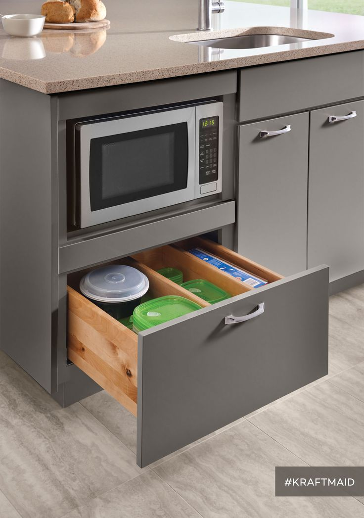 A base microwave cabinet frees up counter space and leaves plenty of room for kitchen storage right underneath. (Cabinets in High-Gloss Greyloft)