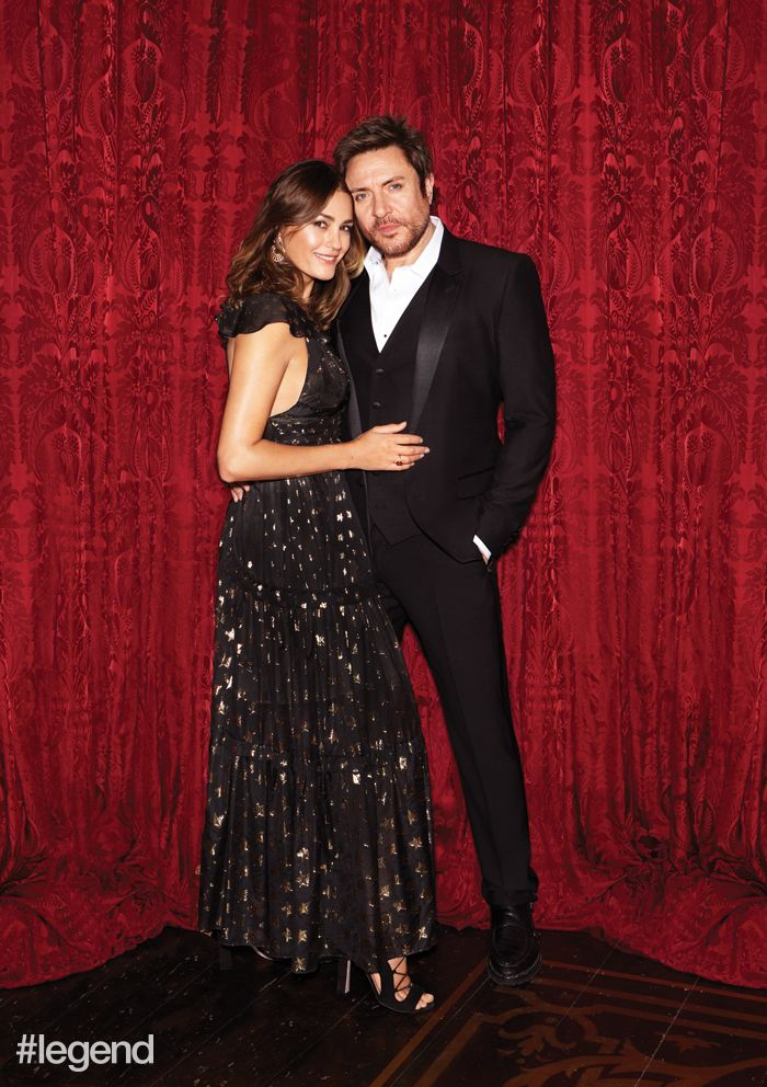 Yasmin wears earrings by Chopard, dress by Temperley London and shoes by Paula Cademartori. Simon wears a tuxedo and shirt by Dolce & Gabbana