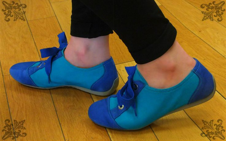 Lindsey loves blue! Her blue suede shoes are by Semler.