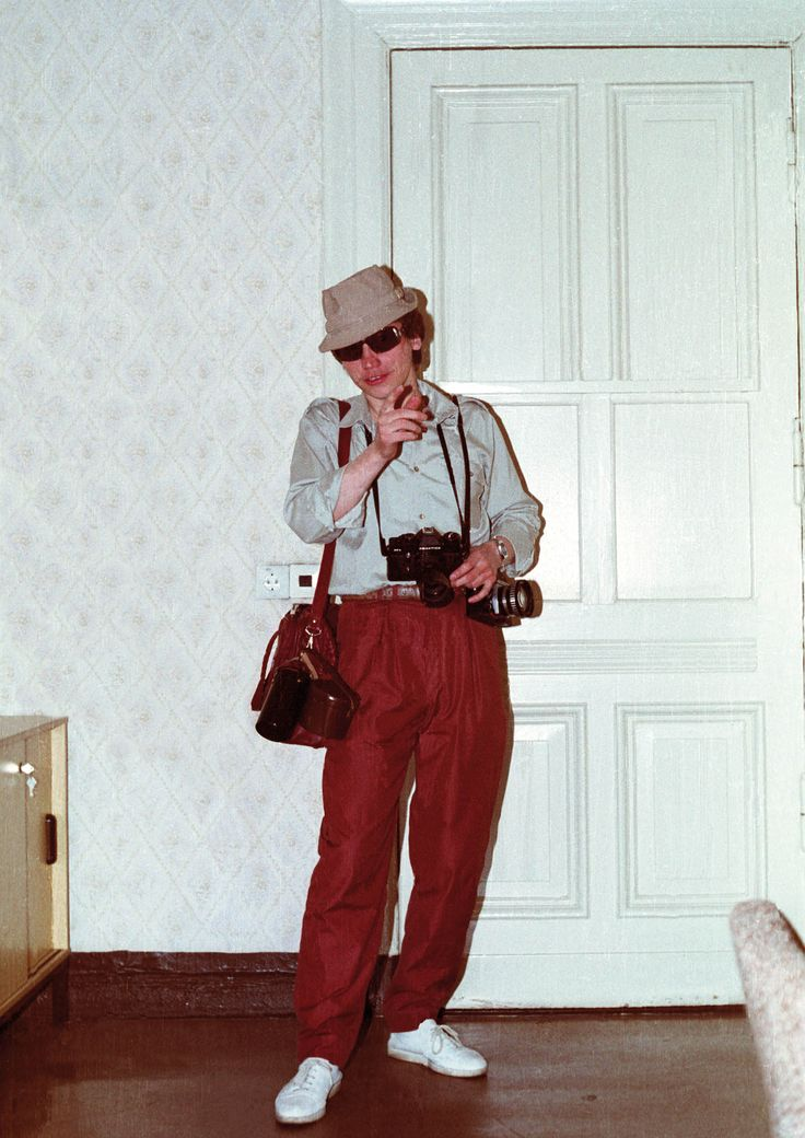 East German Stasi agent demonstrating how to disguise oneself as a Western tourist