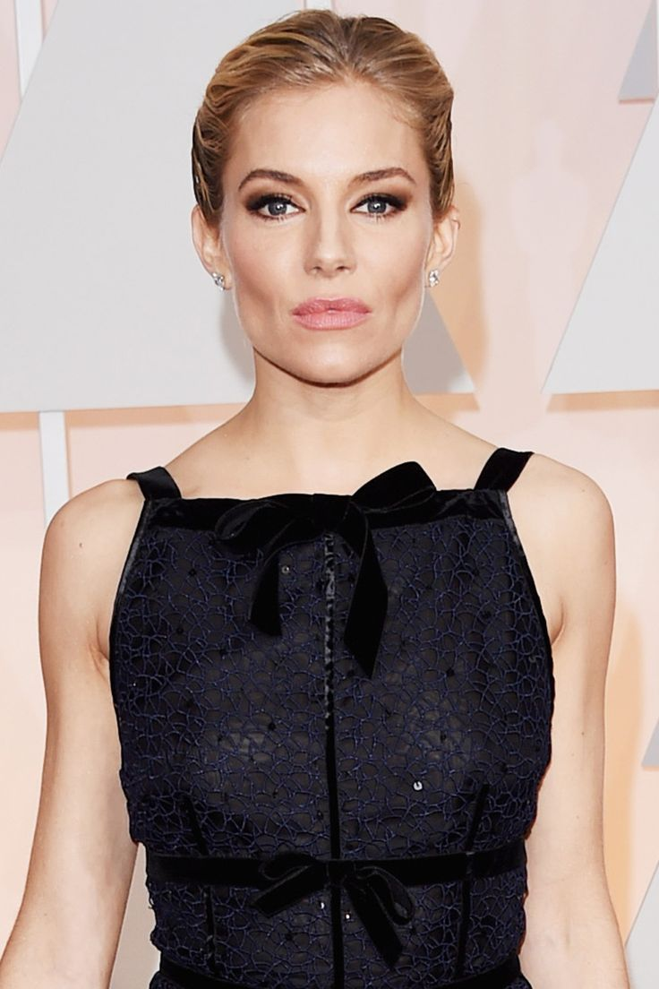 Makeup artist Charlotte Tilbury sculpted Sienna Miller's killer cheekbones with her own Filmstar Bronze & Glow and used Luxury Palette Eyeshadow in The Sophisticate for smoky, rock & roll eyes.   - HarpersBAZAAR.com