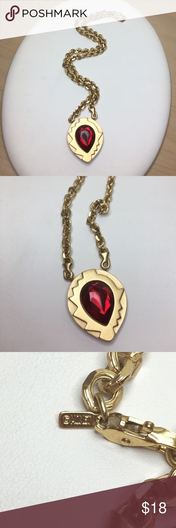 """Vintage Monet Gold and Red Rhinestone Necklace A 1 1/4"""" x 1"""" pear-shaped gold pendant with a large faceted glass rhinestone pendant, strung on an 18"""" thick gold chain with a lobster clasp. Marked as shown at the clasp and on the back of the pendant. Totally 80s style, especially with the modernist style of the pendant! A very cool piece, in excellent vintage condition. Vintage Jewelry Necklaces"""