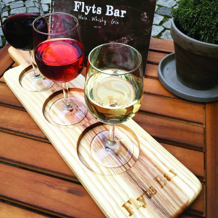 Guten Tag mein Freund! Natural Ash wine sampling paddles with logo by JTWoodworks at jtwoodworksme.com. Flyts Bar courtyard provides a tranquil, beautiful setting in which to relax and enjoy sampling a variety of your favorite drinks.  They have wine, whiskey, gin, rum, and 30 craft beers to choose from...wow!  // Flyts Bar, Ingolstadt, Germany   www.facebook.com/FlytsBar