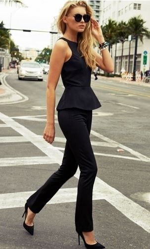 black peplum, all black outfit. very professional. she needs a pop of color though. jewlery or something.
