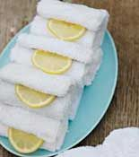 A must for after a lobster, crab or peel-n-eat shrimp meal!Leave guests with a memory of the delicious feast -- not the scent. Before the party, dunk a few washcloths or thick paper towels into cold water. Roll and stack them on a tray and place in the fridge. After the meal, serve them with lemon wedges for partygoers to clean their hands.