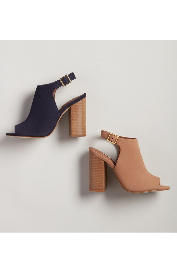 A stacked block heel grounds this effortlessly chic open-toe sandal in trend-savvy style, while the dramatic back cutout provides a breezy finish. From the NSale!