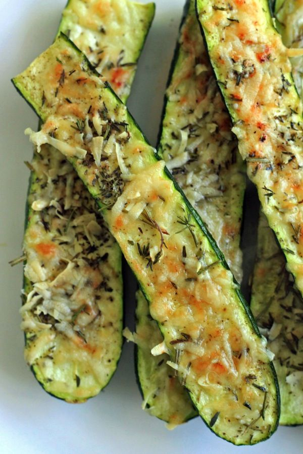 Crusty Parmesan zucchini - Slice zucchini down the middle, lightly brush both sides with olive oil and top with Parmesan cheese and fresh herbs. Salt & pepper to taste.  Bake at 350 degrees for 15 minutes and finish with 3-5 minutes under the broiler until cheese is crispy and browned.