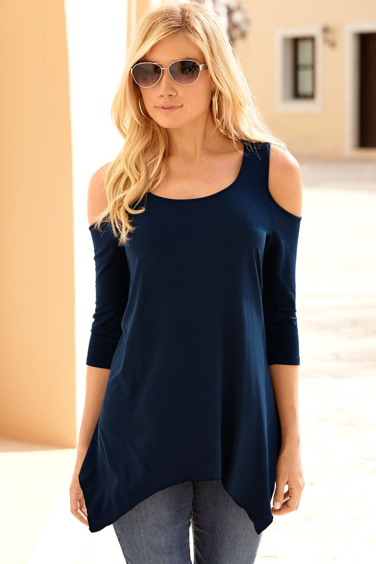 This trapeze tunic is effortlessly chic with a flowing, handkerchief hem, sexy cold-shoulder and scoop-neck style in flattering elbow-length sleeves.