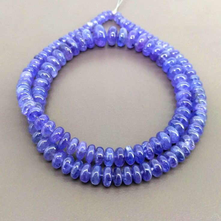 www.gemsbiz.com bargain-bazaar 140478-tanzanite-5-10mm-smooth-rondelle-shape-bead-strands.html