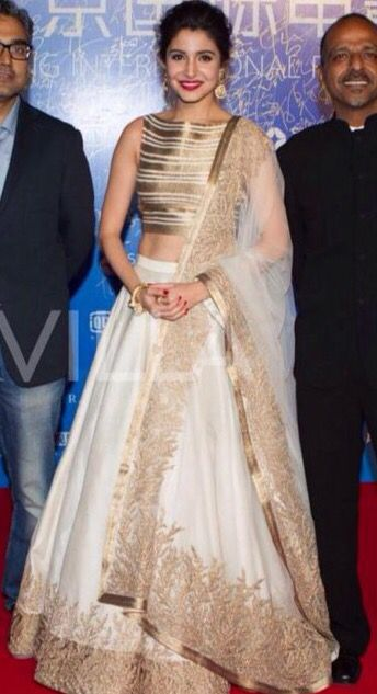 Anushka Sharma wearing a Gold and white designer anarkali.