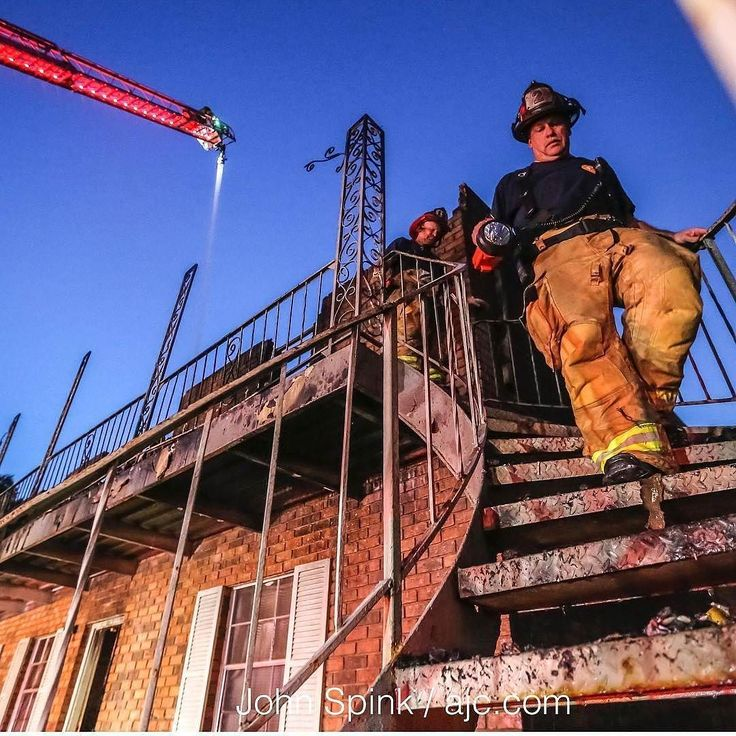 FEATURED POST @jspink1 - Captain Paul Daniels (right) and Captain Jeff Goins descend the stairs after examining the upper floors where a massive fire tore through part of a DeKalb County apartment and displaced 19 people Tuesdaymorning July 11 2017 weeks before a deadline for residents to move out of the complex. Just before 1 a.m. crews were called to the Shallowford Gardens Apartments in the 3600 block of Shallowford Road where they found heavy smoke and flames coming from the center of a…