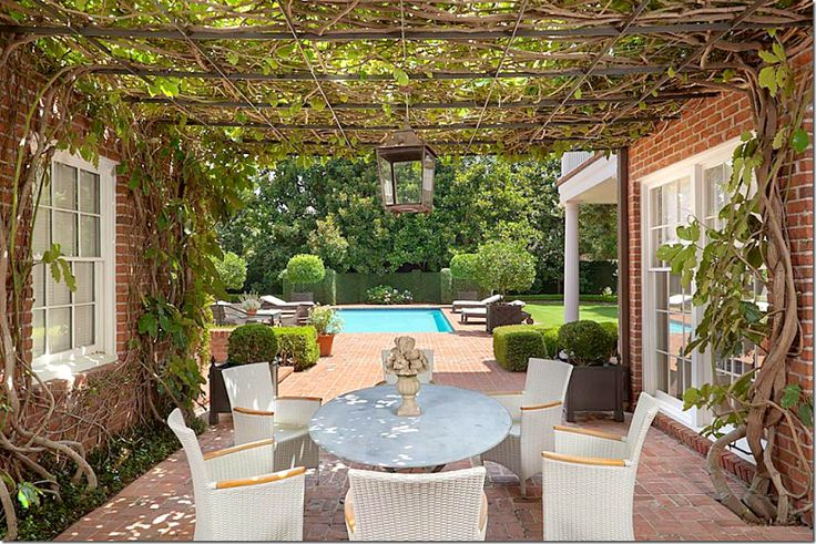 Relaxing Patio With A Beautiful Wisteria Covered Pergola