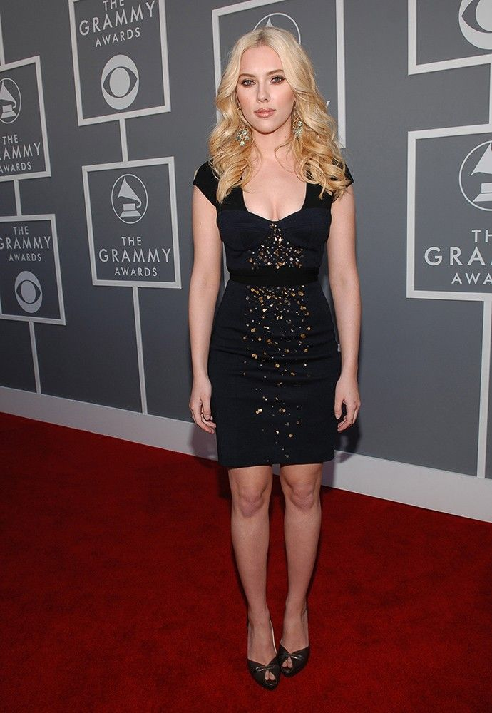 2007: Scarlett Johansson's LBD is of the sparkly, tight-fitting variety, paired with bombshell hair. via StyleList