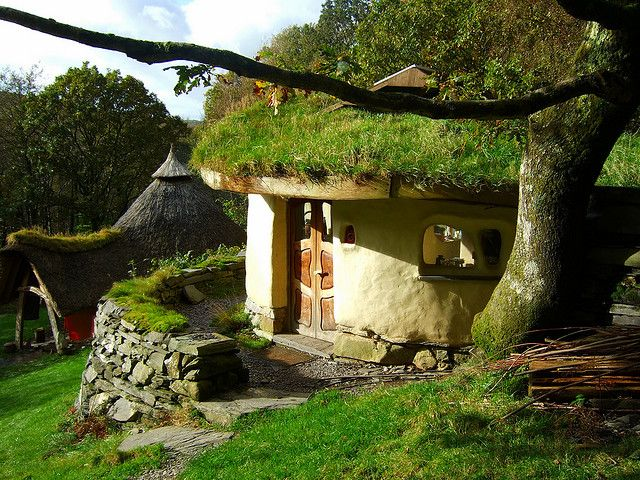 Hobbit House.  AKA Cae Mabon:  Cob Cottage with Roundhouse in the background