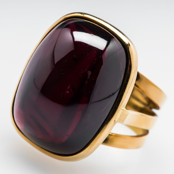 Italian Rajola Cabochon Garnet Cocktail Ring 18K Gold This awesome Italian Rajola cocktail ring is bezel set with a 25 carat cabochon cut natural garnet.
