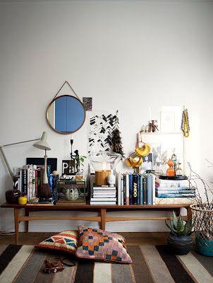 bench styling, books, round mirror, striped rug, kilim pillows, boho chic