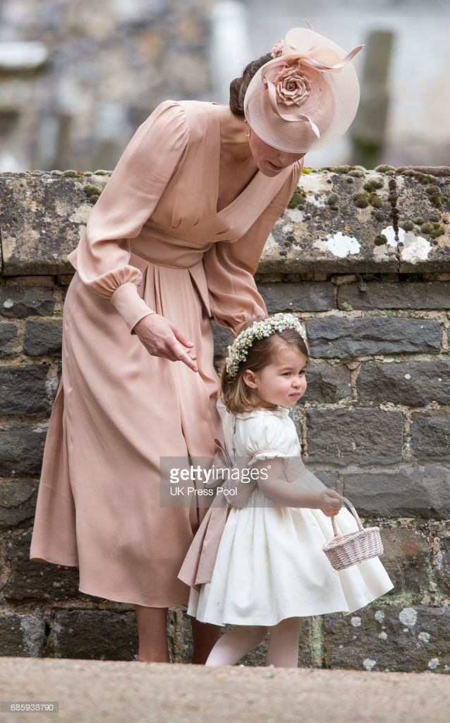 Catherine, Duchess of Cambridge and Princess Charlotte of Cambridge attend the wedding of Pippa Middleton and James Matthews at St Mark's Church on May 20, 2017 in Englefield Green, England.  (Photo by UK Press Pool/UK Press via Getty Images)