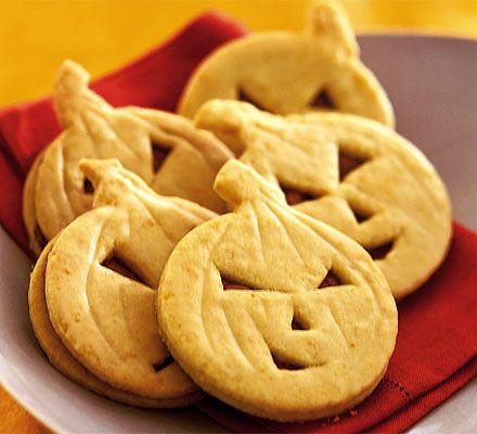 Orange pumpkin face cookies with chocolate mascarpone filling