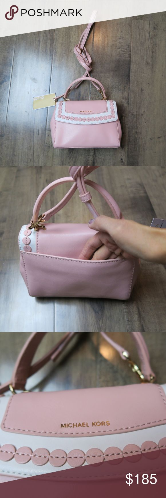 NWT Michael Kors Ava Blossom Crossbody Bag A perfect bag for toting the necessities for brunch! The leather is super soft!  Measurements: 7 inches long, 2.5 inches wide, 6 inches high. Comes with a crossbody strap. Michael Kors Bags Crossbody Bags