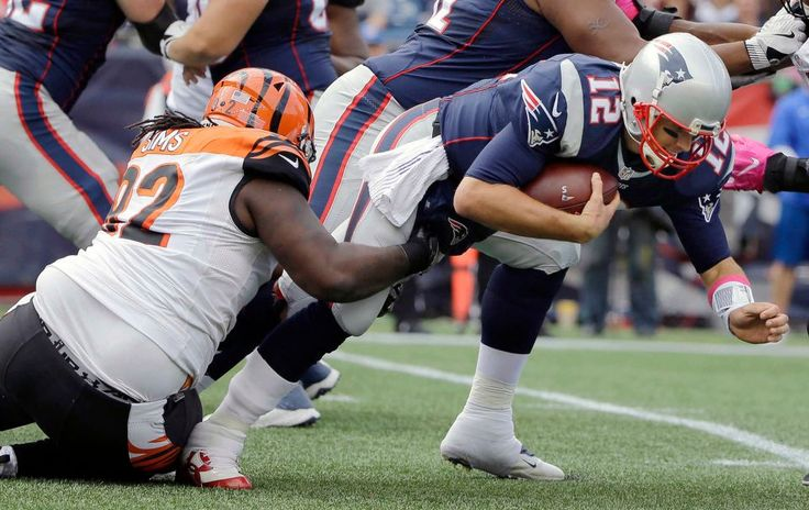 Bengals vs. Patriots:     October 16, 2016  -  35-17, Patriots  -    Cincinnati Bengals defensive tackle Pat Sims (92) sacks New England Patriots quarterback Tom Brady (12) during the first half of an NFL football game, Sunday, Oct. 16, 2016, in Foxborough, Mass.
