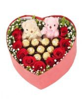 This bouquet consist of intense red roses and Ferraro kisses. Ideal to express your love with chocolates.Includes:9-12 Red Roses,9-12 Ferraro Rocher Kisses, Greenery, Gypsofila, Heart Shaped Box.Same-Day Delivery Available.