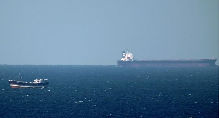 An oil tanker cruises towards the Strait of Hormuz off the shores of Khasab in Oman on January 15, 2011. Iran threatened to close the Strait of Hormuz in the Gulf if extra sanctions bite, cutting off the transport of 20 percent of the world's oil as United States warned that Iran would cross a