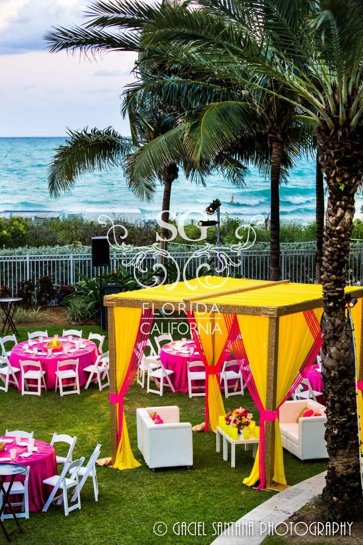 Suhaag Garden, outdoor cabanas, Florida California Atlanta Indian wedding decorators, outdoors wedding decor, outdoors mehndi decor, neon decor, glitter, flameless candles, string lights
