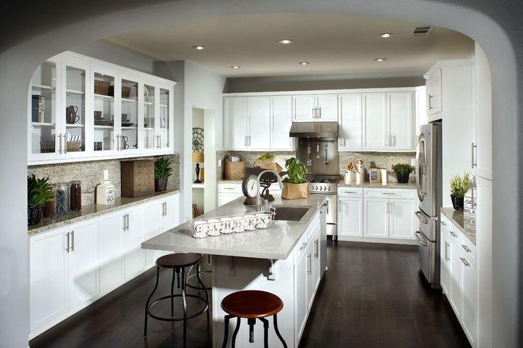 Modern Kitchen with Breakfast bar, Simple granite counters, Decorative Art Glass Cabinets, Simple Granite, Hardwood floors